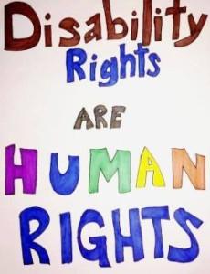 """Un poster realizzato negli Stati Uniti, con la scritta """"Disability Rights are Human Rights"""", ovvero """"I diritti delle persone con disabilità sono diritti umani""""."""